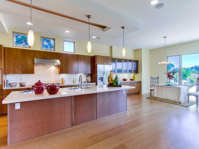 Open kitchen with maple cabinets and reeded glass doors